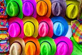 image of panama hat  - Stacks of colorful hats line the sidewalks in Cartagena - JPG