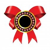 shiny golden badge with red ribbon and jewels