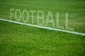 Football text on grass with white lane