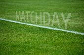 Football Matchday text on grass with white lane