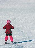 Little Girl Driving On Skis