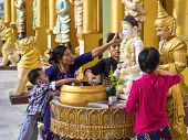 Bathing Of Buddha Statue At Shwedagon Pagoda In Yangon, Myanmar