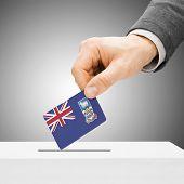 Voting Concept - Male Inserting Flag Into Ballot Box - Falkland Islands