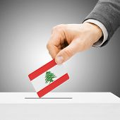 Voting Concept - Male Inserting Flag Into Ballot Box - Lebanon