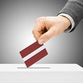 Voting Concept - Male Inserting Flag Into Ballot Box - Latvia