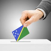 Voting Concept - Male Inserting Flag Into Ballot Box - Solomon Islands