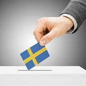 Voting Concept - Male Inserting Flag Into Ballot Box - Sweden