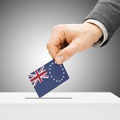 Voting Concept - Male Inserting Flag Into Ballot Box - Cook Islands