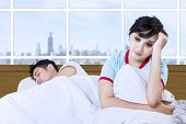 Asian Couple Insomnia At Bedroom Apartment