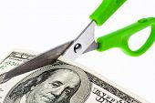 dollar bills and scissors