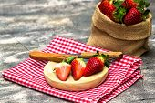 Group Of Strawberries On Wooden Plate And Sack