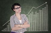 Successful Businesswoman With Upward Graph