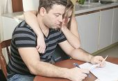 foto of eviction  - A men with financial stress at home - JPG