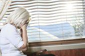 foto of 70-year-old  - A senior portrait of a woman having a headache - JPG