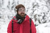 Young Man With Snow Glasses Smiles Into The Camera
