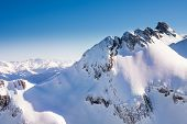 foto of caucus  - Caucasus mountains high view during winter daytime in Sochi ski resort Krasnaya polyana - JPG