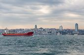 Bosphorus with buildings and cargo ship, Istanbul