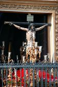 Crucifix being carried out of church.