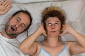 pic of deprivation  - Husband snoring sleep and leaves his wife  - JPG
