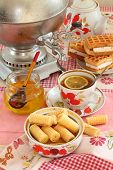 Tea From A Samovar, With A Lemon, Honey, Cakes And Wafers
