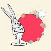 Cute bunny standing in crossed arm pose with beautiful pink circle frame and space for your text.