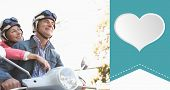 Happy senior couple riding a moped against heart label