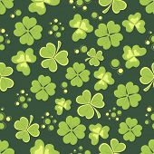 Pattern with shiny shamrock leaves for St. Patrick's Day celebrations.