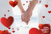 Bride and groom holding hands close up against cute valentines message