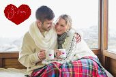 Loving couple in winter wear with cups against window against valentines love hearts