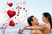 Couple embracing in the pool against valentines heart design