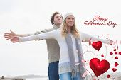 Happy casual young couple stretching hands out against cute valentines message