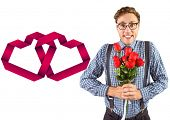 Geeky hipster holding a bunch of roses against linking hearts