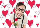Geeky lovesick hipster holding rose against valentines day pattern