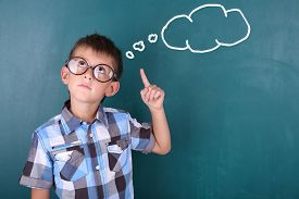 image of schoolboys  - Schoolboy at blackboard in classroom and text cloud with space for your text - JPG