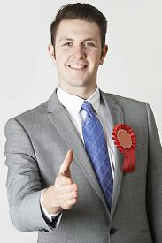 foto of politician  - Portrait Of Politician Reaching Out To Shake Hands - JPG