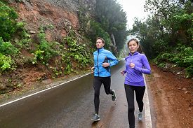 image of cardio exercise  - Healthy lifestyle people running on country road exercising - JPG