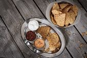 picture of nachos  - nachos with tomato salsa and sour cream - JPG