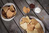 image of nachos  - nachos with tomato salsa and sour cream - JPG