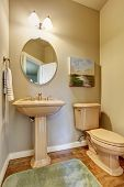 stock photo of bathroom sink  - Small half bathroom with toilet sink and wooden floor - JPG