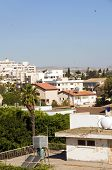 stock photo of larnaca  - rooftop cityscape view of Larnaca Cyprus hotels condos apartments offices with Mediterranean sea and mountains in distance vertical - JPG