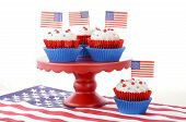 pic of red velvet cake  - Happy Fourth of July Cupcakes on red stand with USA flags on white wood shabby chice table - JPG