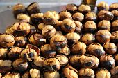 stock photo of spit-roast  - Roasted Chestnuts on Street Market in Istanbul - JPG