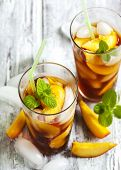 pic of iced-tea  - Peach Ice Tea in glass cup on wooden table - JPG