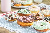 stock photo of racks  - Homemade colorful donuts on a cooling rack - JPG