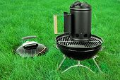 stock photo of briquette  - BBQ Kettle Portable Grill Appliance With Charcoal Briquettes Starter On The Summer Lawn Picnic Or Cookout Concept - JPG