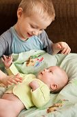 foto of little sister  - the boy playing with his little sister - JPG