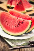 foto of watermelon slices  - Fresh watermelon slices on the plate close up - JPG