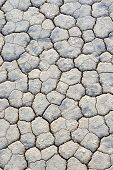 stock photo of mud  - Extreme Closeup Of Dry and Cracked Mud Soil in Racetrack Playa in Death valley National Park in California - JPG