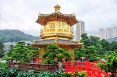pic of hong kong bridge  - The Golden pavilion and red bridge in the Nan Lian Garden near the Chi Lin Nunnery a famous landmark in Hong Kong - JPG
