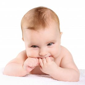 foto of teething baby  - portrait baby teething bites sucking the hand - JPG